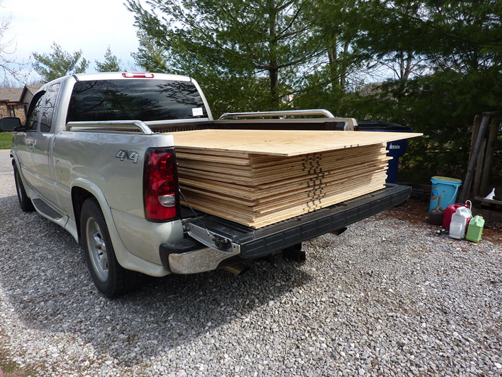 Truck loaded with sheets of cheap plywood for the floors