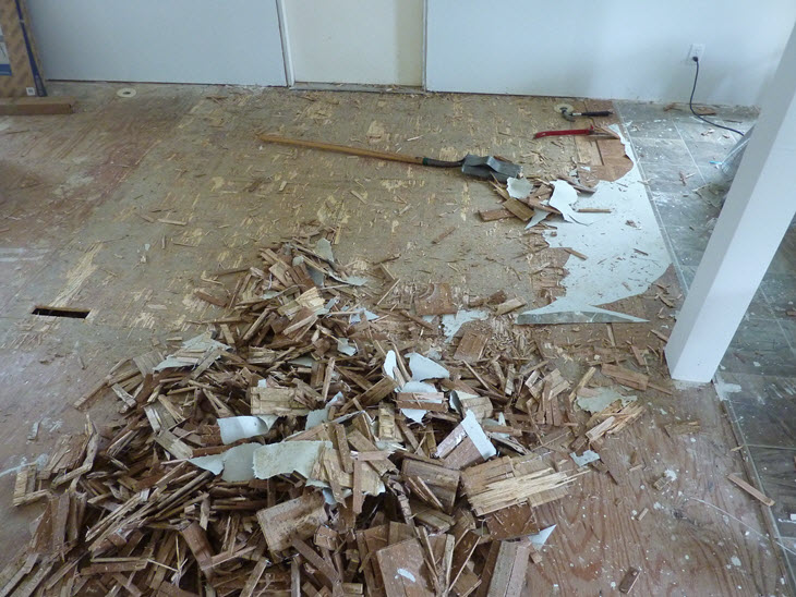 Tearing out the old vinyl floor coving an old parquet floor.