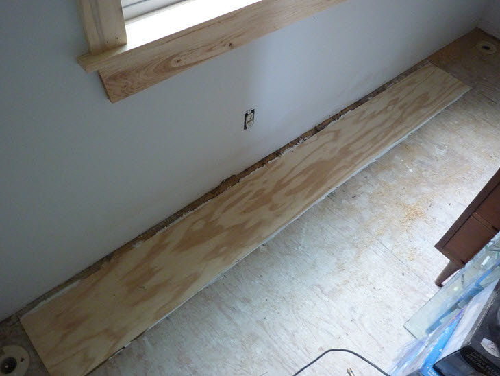 Subfloor patches under the old leaking windows.