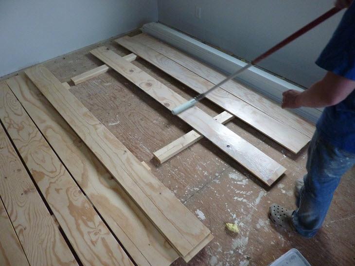White washing plywood plank flooring.