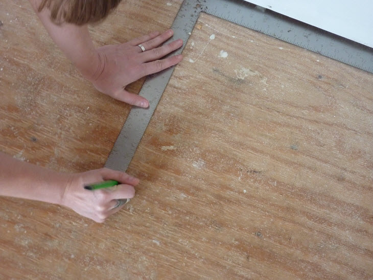 Measuring and marking the first layout lines for the new flooring