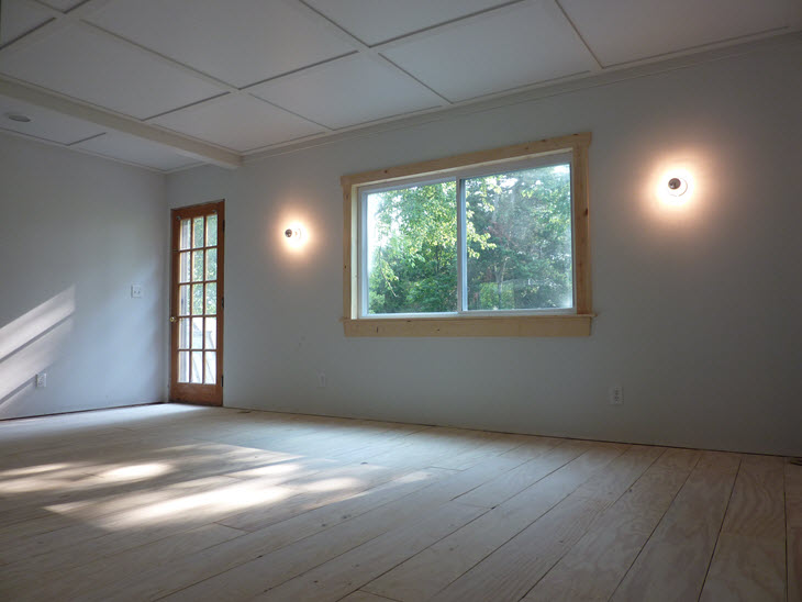 Unfinished plywood floors with board and batten ceilings