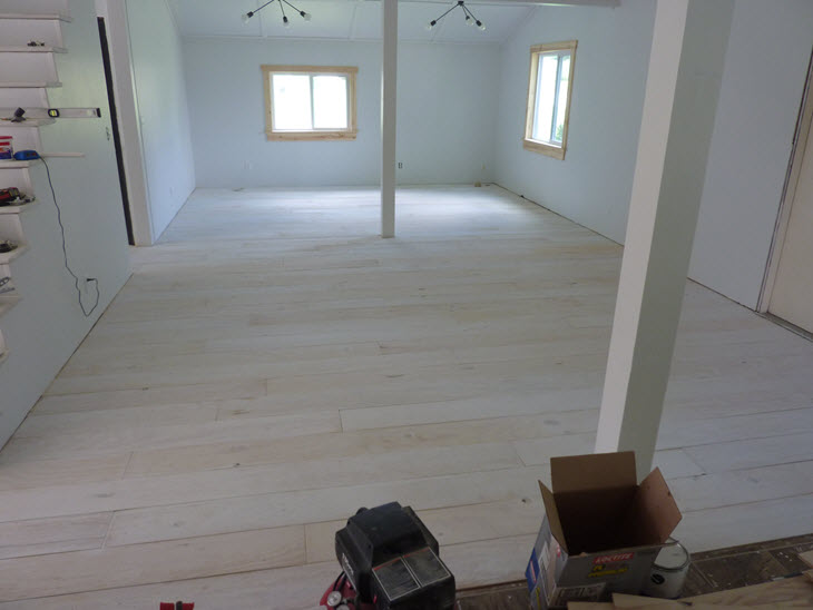 Freshly installed plywood floors in the living room