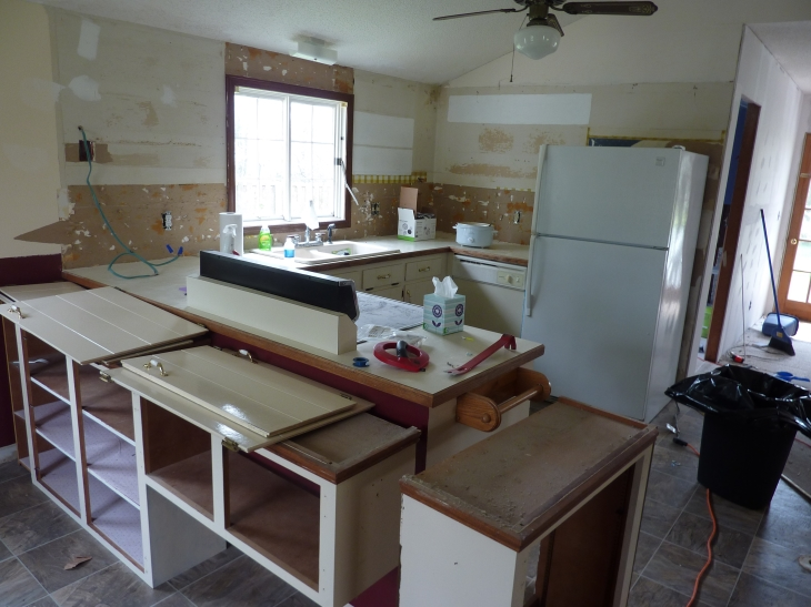 Tearing out the old barn house cabinets