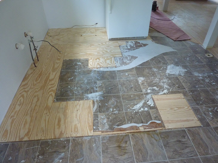 The kitchen floor is totally patched up with new plywood