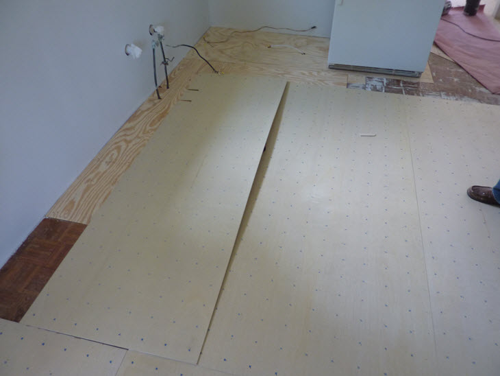 Covering the barn house kitchen & dining room floors with underlayment