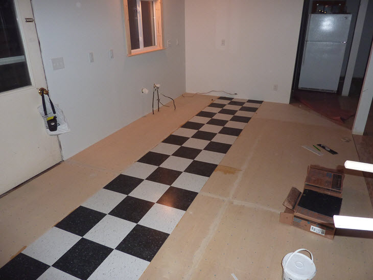 The first 3ft wide strip of tiles installed