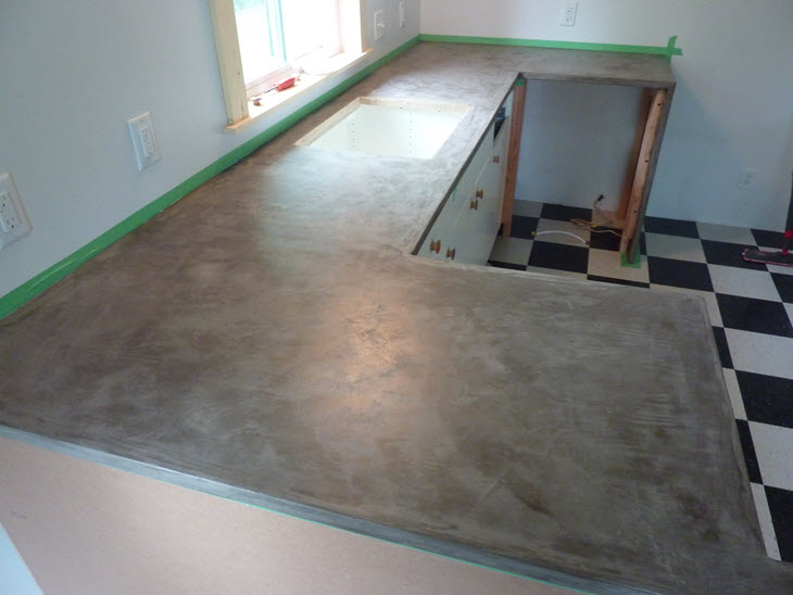 The Ardex concrete countertops sanded smooth and clear coated